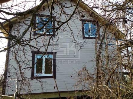 Отделка фасада имитатором бруса